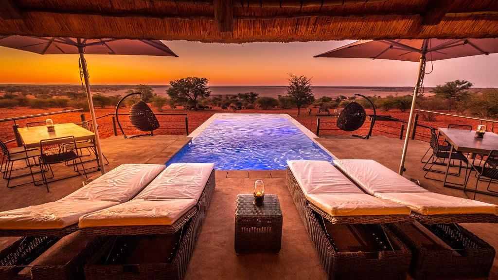 Ausblick vom Bagatelle - Das Boutique Farmhaus in Namibia   Abendsonne Afrika