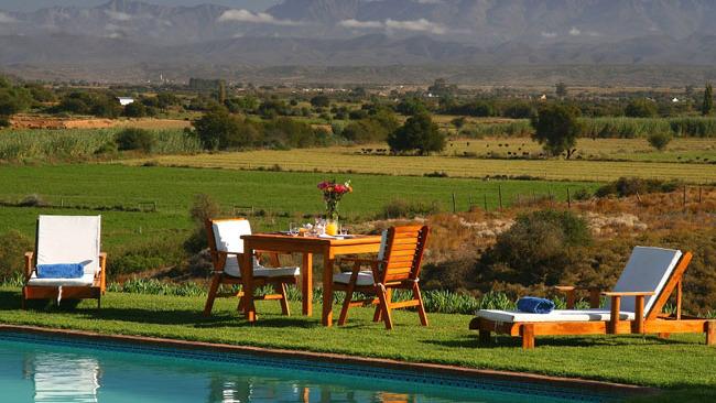 Pool im De Denne Country Guest House, Oudtshoorn, Südafrika | Abendsonne Afrika