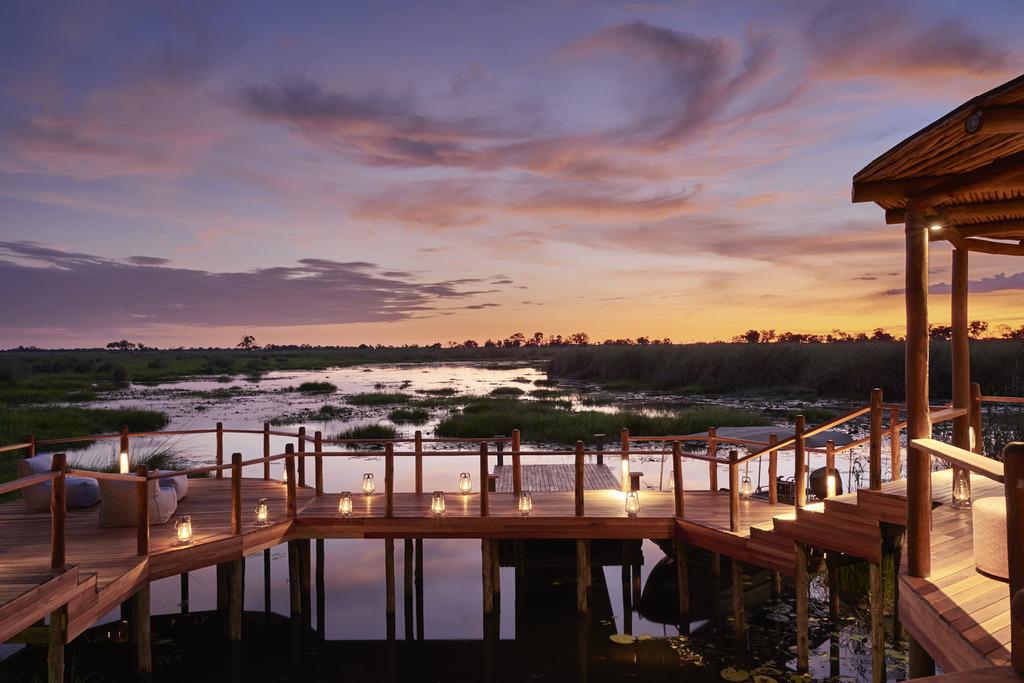 Sonnenuntergang im Sanctuary Baines Camp in Botswana | Abendsonne Afrika