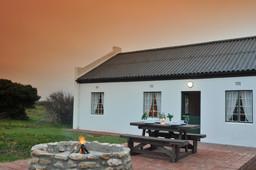 Lagerfeuer in der De Hoop Collection in Südafrika | Abendsonne Afrika